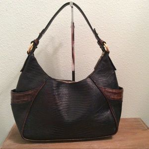 Brahmin black leather purse with brown outside.
